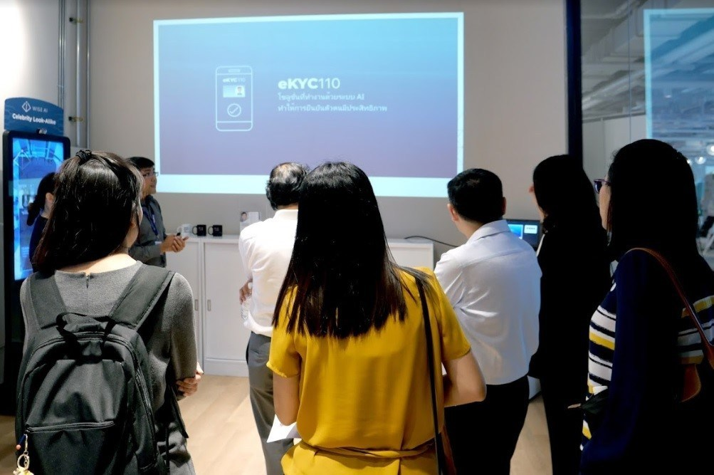 Visitors viewing WISE AI's eKYC110 presentation.